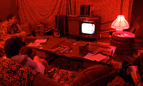 1960s period TV room bathed in red light