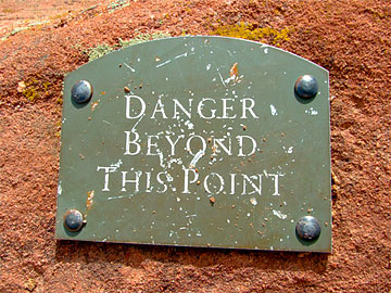 A sign that says Danger Beyond This Point