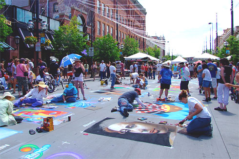 Many chalk artists drawing on the street