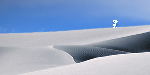 Marco the Spacefarer standing on a white sand dune