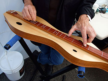 Old man playing an Appalachian Dulcimer
