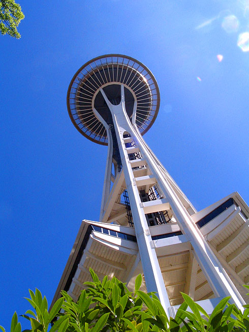 Space Needle towering above into clear blue sky