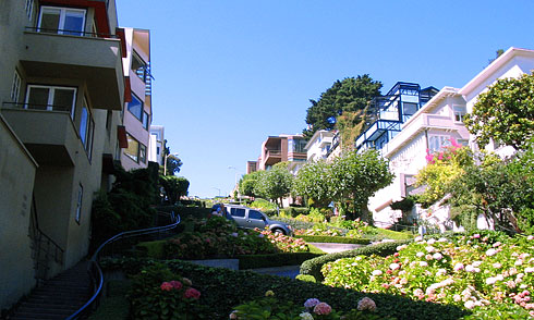 Boxy apartments casting shadows on Lombard Street