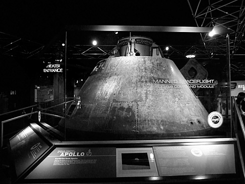 Apollo 8 Command Module behind glass