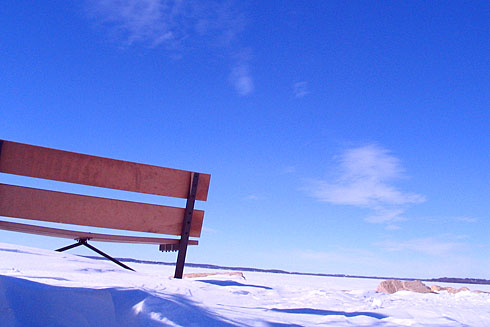 Blue Sky behind Wooden Bench