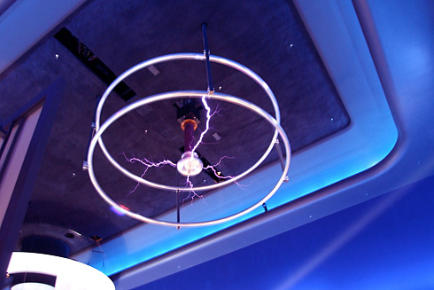 Purple bolts of Tesla Coil on ceiling