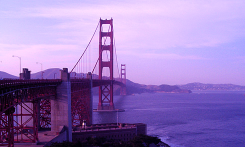 Golden Gate Bridge spanning bay with Fort Point Light below