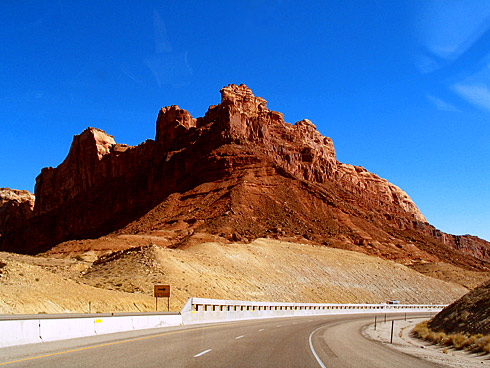 Red sandstone formation above highway