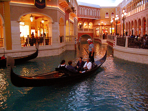 Four people on Gondola inside The Venetian Hotel