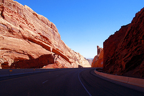 Red sandstone formation beside highway