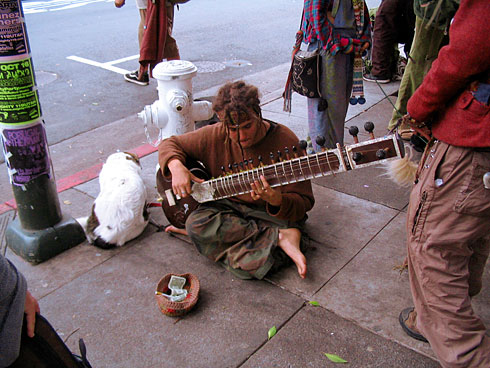 Street Performer playing sitar (busking)