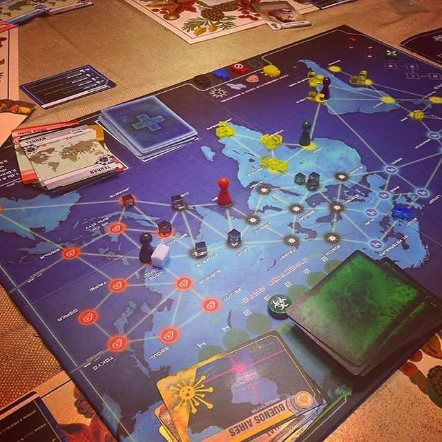 Pandemic Board game with lots of yellow disease