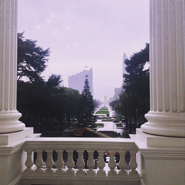 Looking down a rainy street from California State Capitol
