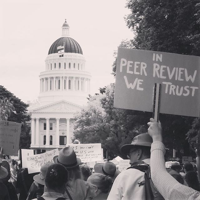 March for Science signs and In Peer Review We Trust