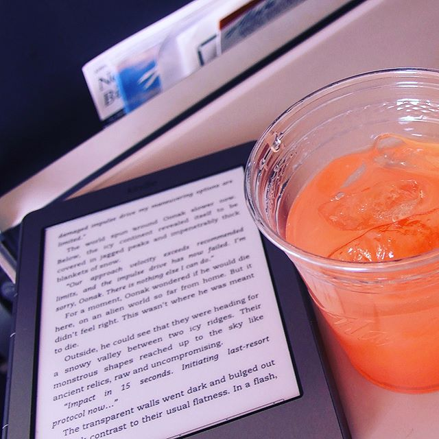 Reading my Kindle on my flight to the Big Island