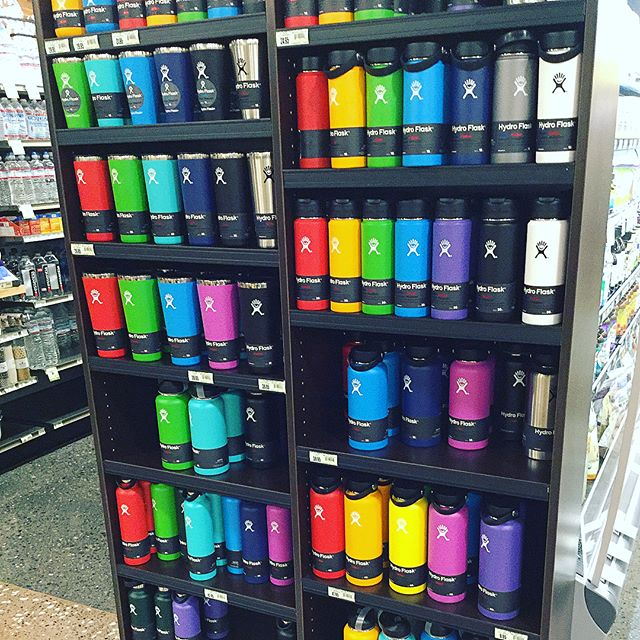A Rainbow of Hydroflasks in Market of Choice grocery store