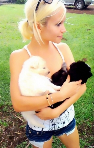 Ashley holding wolf puppies