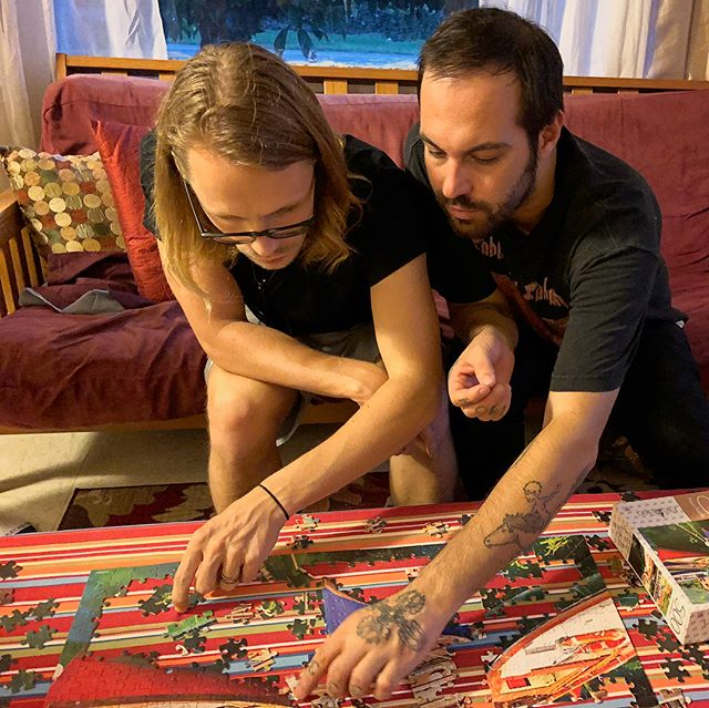 Two Great People (Sean Crowne & Phil Payson) intensely working on a puzzle