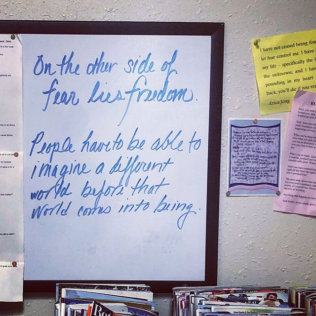 On Other Side of Fear lies Freedom quote on dry-erase board