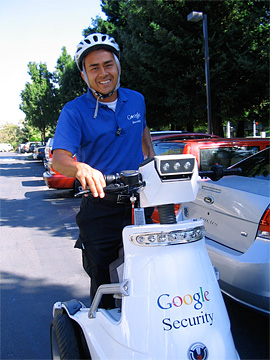 Google Security guy on electric scooter